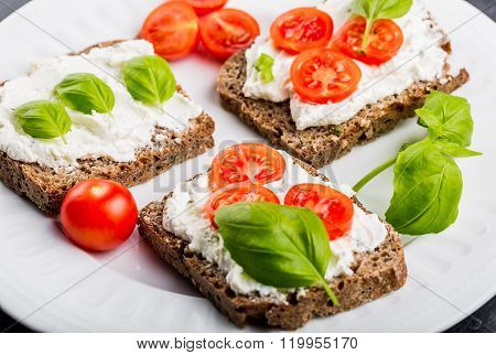 Sandwiches With Soft Cream Cheese, Cherry Tomatoes And Fresh Basi