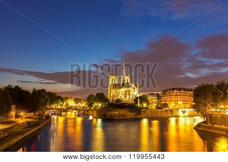Notre Dame Cathedral with Paris cityscape and River Seine at dusk, France
