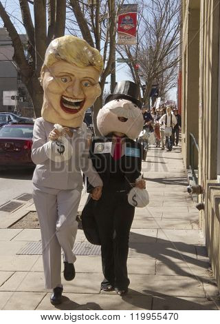 Hillary And Mr. Monopoly Characters Consort During A Bernie Sanders Rally