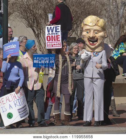 Hillary Holding Money Bags Is Confronted By Bernie Sanders Supporters