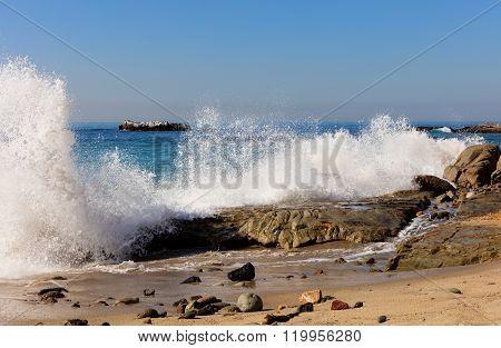 Ocean Waves Hitting Rocks On Laguna Beach In California