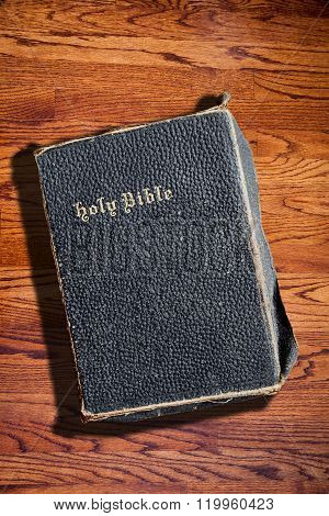Old Rugged Holy Bible On Wood Texture Background