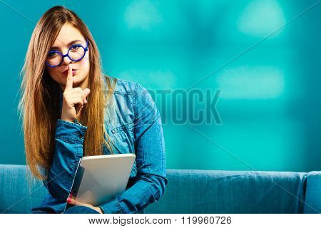 Woman With Tablet Sitting On Couch Blue Color