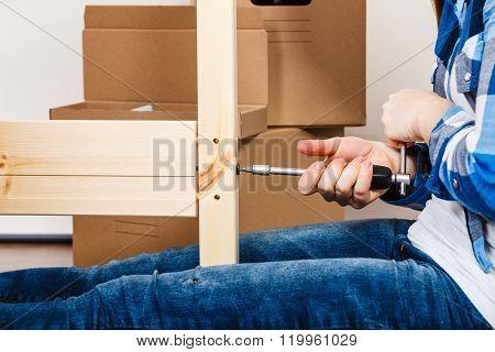 Assembling Wood Furniture Using Scredriver. Diy.