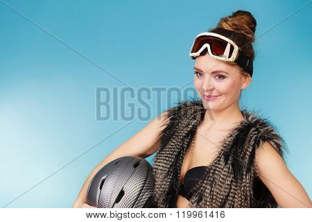 Woman Seductive Girl In Ski Googles Holds Helmet