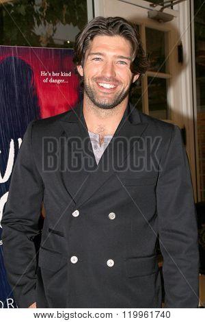 Actor and model Bo Roberts arrives at Victoria Pratt's