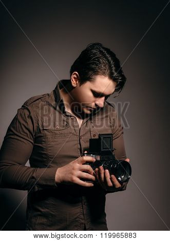 Photographer With An Old Camera.