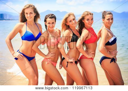 Closeup Cheerleaders In Bikinis Stand Closely In Line On Beach