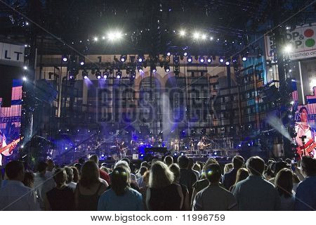 FLUSHING, NY - JULY 16: Concert goers watch singer Billy Joel on stage as he performs at Shea Stadium on July 16, 2008 in Flushing, New York.
