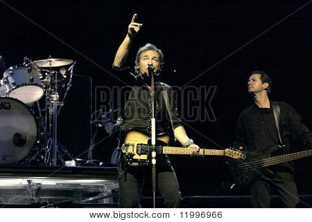 NEW YORK - OCTOBER 4:  Singer Bruce Springsteen (C) and the E Street Band perform their last show for the 2002-03 World Tour at Shea Stadium October 4, 2003 in Flushing, New York.