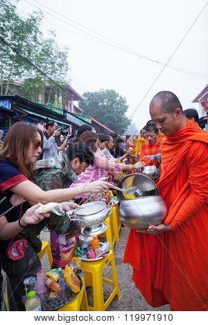 Sangkhlaburi, Thailand - December 27, 2015: Traveler Crowd Make Merit With Monk, In Morning At Sangk