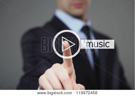 Businessman pressing play music button