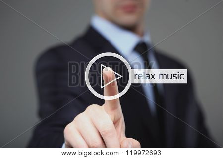 Businessman pressing play relax music button