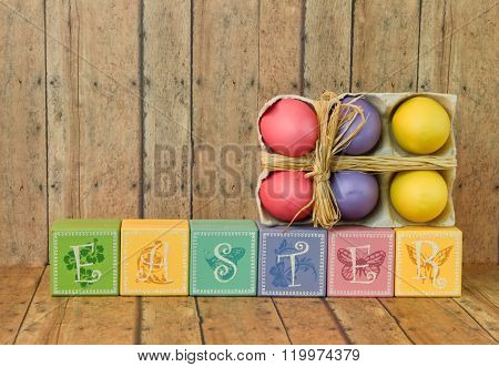 Easter Blocks With Colorful Easter Eggs On A Wood Background