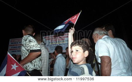 LITTLE HAVANA, FL - APRIL 14: Protesters gather near the family home of Elian Gonzalez on April 14, 2000 in Little Havana, Florida. Elian was forcibly taken into custody on April 22.