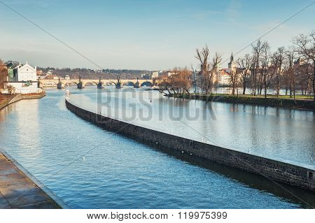 Embankment Of The Vltava River And View Of The Charles Bridge In Prague