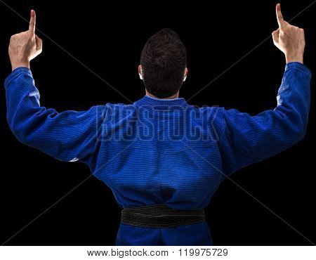 Judoka fighter isolated on black background