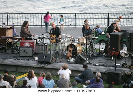 NEW YORK - JULY 1: Blues singer John Hammond (C) performs at Wagner Park with drummer Neil Gouvin (2nd-R), bassist Marty Ballou (R) and keyboardist Bruce Katz (L) on July 1, 2010 in New York City.