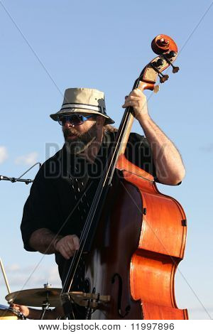NEW YORK - JULY 1: Bassist Marty Ballou performs at Wagner Park on July 1, 2010 in New York City.