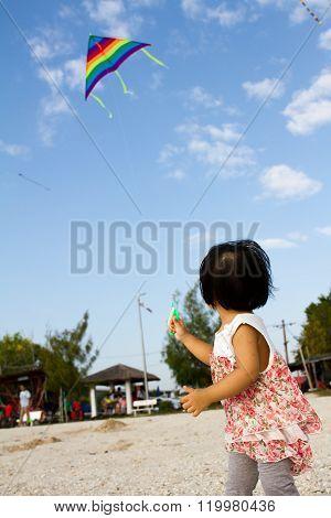 Asian Little Chinese Girl Flying Kite