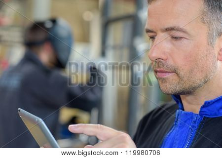 Man using tablet computer