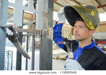 welder checking his work