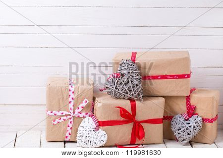 Festive gift boxes and grey and whute decorative hearts