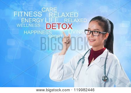 Doctor hand touching DETOX word on screen with blue background. medical concept
