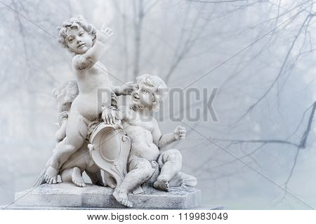 Statue Of Small Boys In Park. Vienna, Austria.