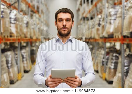 wholesale, logistic, business, export and people concept - man or manager with tablet pc computer at warehouse