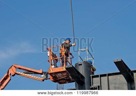 Construction Worker On A Raised Platform 2