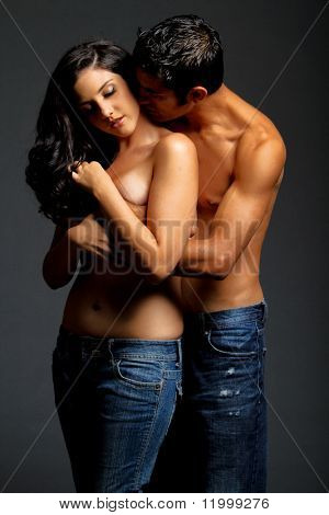 Sensual couple in blue jeans