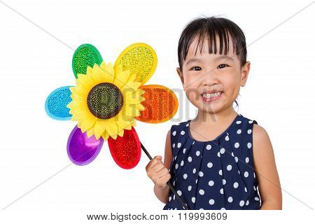 Asian Little Chinese Girl Holding Colorful Windmill
