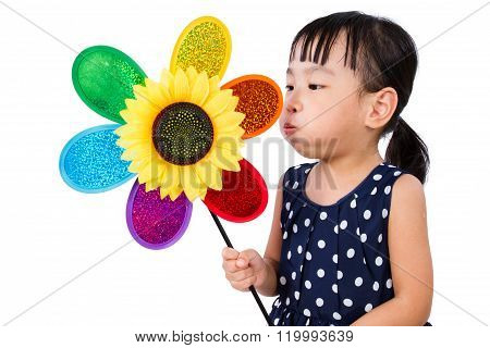 Asian Little Chinese Girl Blowing Colorful Windmill
