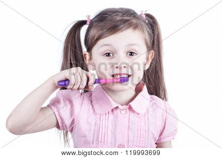 Nice child girl with toothbrush isolated on white