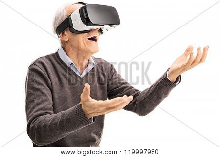 Amazed senior gentleman using a VR headset and gesturing with his hands isolated on white background