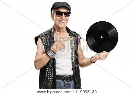 Senior punk rocker holding a vinyl and pointing to it with his finger isolated on white background