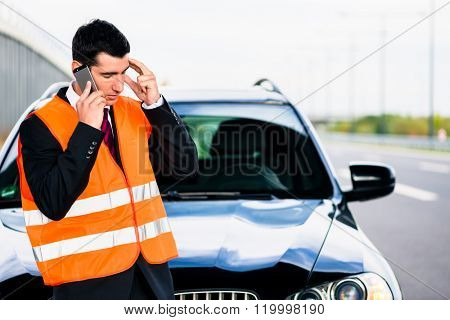 Man with car breakdown calling towing company