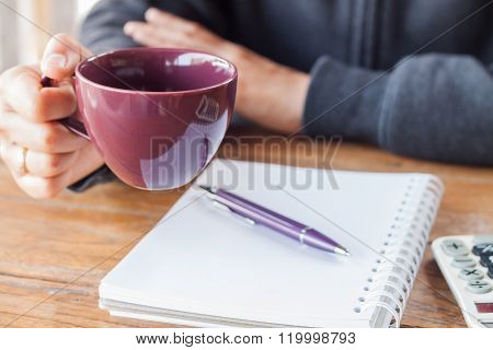 Woman Hand Holding A Cup Of Coffee