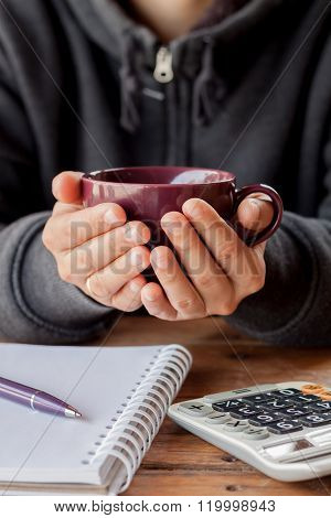 Woman Hands Holding A Cup Of Coffee
