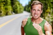 Athlete on intense cardio running workout. Closeup portrait of male sprinter or long distance runner poster