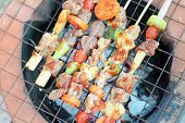 Постер, плакат: Bar B Q or BBQ with kebab cooking