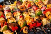 Постер, плакат: BBQ with kebab cooking