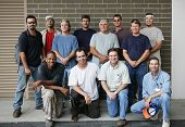 Technical college class photo of a group of handsome blue collar working men.  Diverse ages and ethn