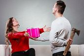 Insincire Man Holding Axe Giving Gift Box To Woman poster