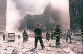 NEW YORK - SEPTEMBER 11:  New York City firefighters work near the area known as Ground Zero after t