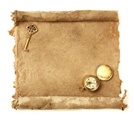 stock photo of treasure map  - Handmade paper scroll with key and a compass - JPG
