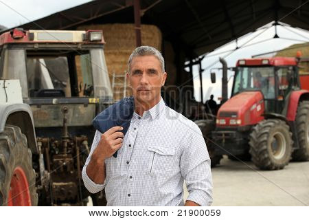 A farmer posing with his tractors