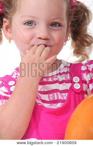 Girl with fingers in mouth