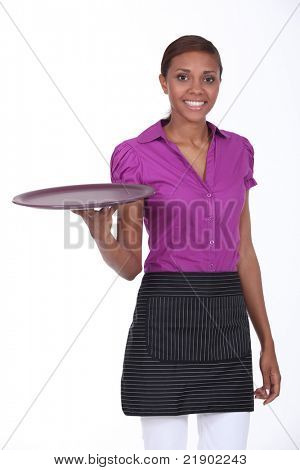 Waitress in a cafe holding an empty tray